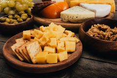 Cheese on wooden cutting board Stock Photo