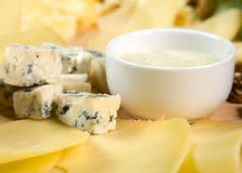 Cheese on wooden platter Royalty Free Stock Image