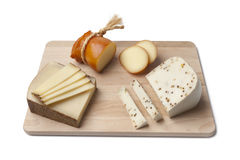 Cheese on wooden platter Stock Images