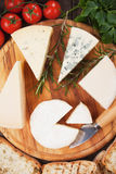 Cheese on wooden platter Royalty Free Stock Photo