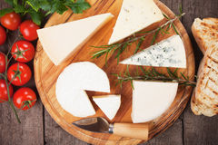 Cheese on wooden platter Stock Photography