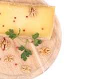 Cheese on wooden platter with walnuts. Stock Image