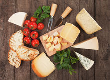 Cheese on wooden table Royalty Free Stock Photography