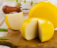 Cheese on a wooden table Stock Photos