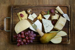 Cheeseboard with assorted cheeses Stock Photo