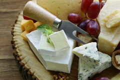 Cheeseboard with assorted cheeses royalty free stock photo