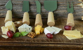 Cheeseboard with assorted cheeses Royalty Free Stock Images