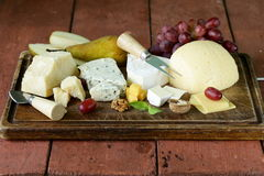Cheeseboard with assorted cheeses Royalty Free Stock Photography