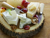 Cheeseboard with assorted cheeses Stock Photography