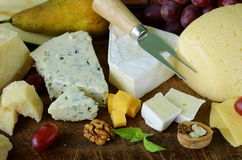 Cheeseboard with assorted cheeses stock photos