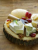 Cheeseboard with assorted cheeses Royalty Free Stock Photos