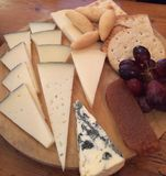 Cheeseboard with biscuits and grapes royalty free stock photo