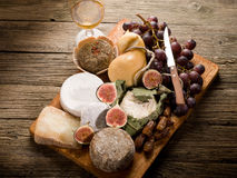 Cheeseboard  with cheese and fruit Royalty Free Stock Photos