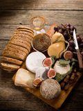 Cheeseboard  with cheese and fruit. Cheeseboard  with an assortment of cheeses bread and fruits Stock Image