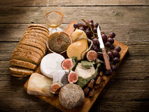 Cheeseboard  with cheese and fruit Stock Photos
