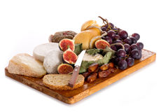 Cheeseboard  with cheese and fruits. Cheeseboard  with an assortment of cheeses  and fruits Royalty Free Stock Photo