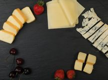 Cheeseboard with Cheese Mix stock images