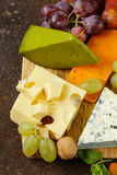Cheeseboard with different types of cheese Stock Photo