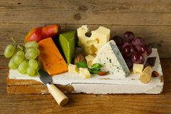 Cheeseboard with different types of cheese Stock Image