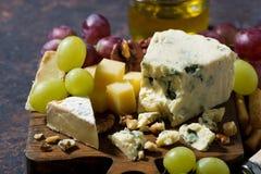 Cheeseboard, fresh fruits and honey, horizontal. Closeup Stock Photo