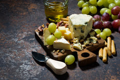Cheeseboard, fresh fruits and honey, top view. Horizontal Royalty Free Stock Photos