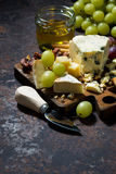 Cheeseboard, fresh fruits and honey, top view vertical. Cheeseboard, fresh fruits and honey, vertical Stock Photo