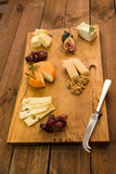 Cheeseboard with fruit and herbs Royalty Free Stock Photos