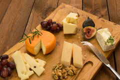 Cheeseboard with fruit and herbs Stock Image