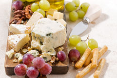 Cheeseboard, fruits and honey on a white background, closeup. Horizontal Royalty Free Stock Images