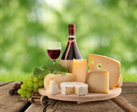 Cheeseboard, grape and red wine Stock Photos