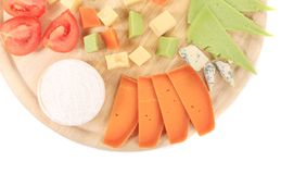 Cheeseboard. Isolated on a white background Royalty Free Stock Photos