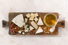 Cheeseboard on a white background, top view. Horizontal Stock Photo
