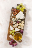 Cheeseboard on a white background, top view vertical. Cheeseboard on a white background, vertical Stock Photo