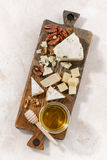 Cheeseboard on a white background, vertical. Top view Stock Photos