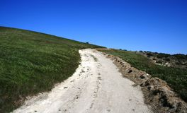 Cheeseboro Ridge Trail 2. Fire road on a grassy hillside under blue sky, California Stock Photos