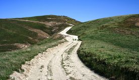 Cheeseboro Ridge Trail. Fire road on a grassy hillside under blue sky, California Royalty Free Stock Photography