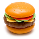 Cheeseburger. Plastic toy cheeseburger with lettuce, tomato on a seasame seed bun - on isolated white background royalty free stock image