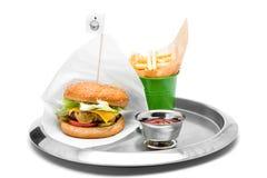 Cheeseburger avec les fritures et le ketchup Photographie stock