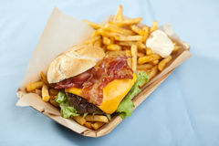 Cheeseburger with bacon and fries Royalty Free Stock Photography