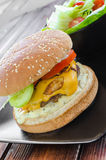 Cheeseburger with bacon and tartar sauce and garden salad Stock Images