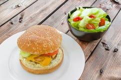 Cheeseburger with bacon and tartar sauce and garden salad Stock Photos