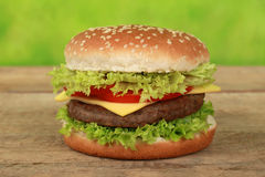 Cheeseburger. With beef, tomatoes, lettuce and cheese royalty free stock photos