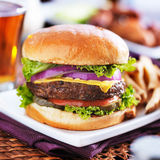 Cheeseburger with beer Royalty Free Stock Image