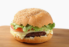 Cheeseburger on a board Royalty Free Stock Images