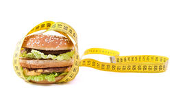 Cheeseburger and centimeter Royalty Free Stock Images