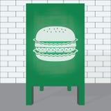 Cheeseburger  on chalkboard. Stock Photos