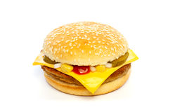 Cheeseburger with cheese, pickles, onion and sauce Royalty Free Stock Photo