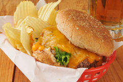 Cheeseburger with chips and beer Stock Photography