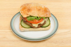 Cheeseburger in a ciabatta roll stock photos