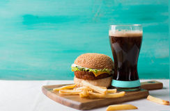 Cheeseburger with cola Stock Photo